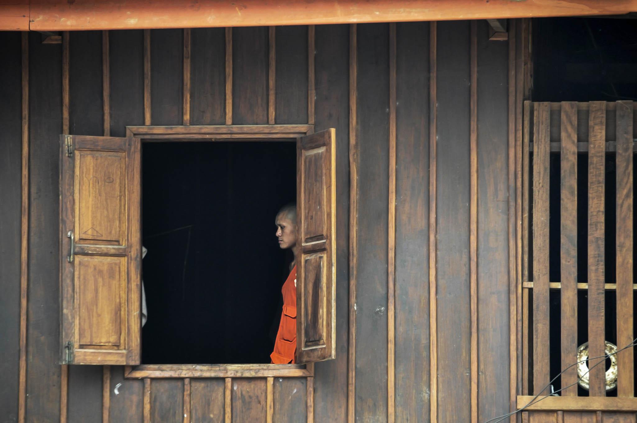 Monnik in klooster Laos